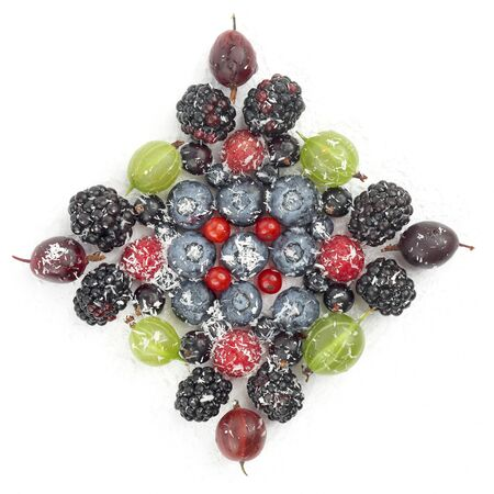 lot of different berries in the shape of a square on a white background. healthy fresh vegetables and food Imagens