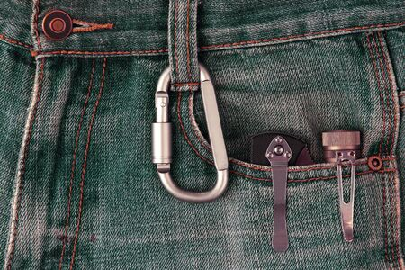metal carabiner and tools on the jeans. everyday tools Imagens