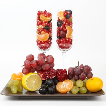 two glasses filled with fruit on a light background. healthy fresh vegetables and food Imagens