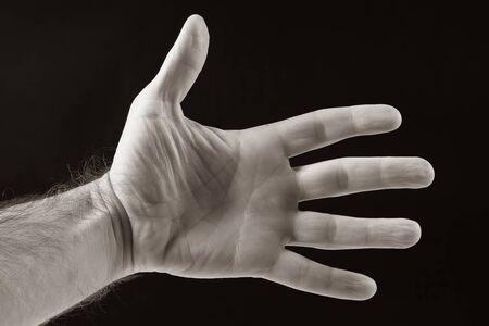 left hand men on a dark background