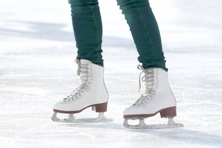 feet skating girl skating on ice rink. sports, Hobbies and recreation of active people