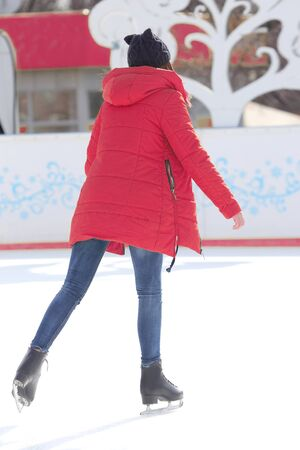 girl skates on ice rink. sports, Hobbies and recreation of active people Imagens