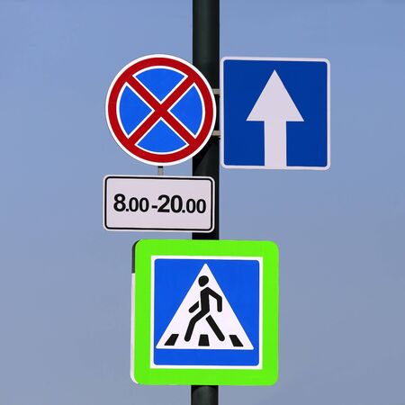 different road signs on a pole Imagens