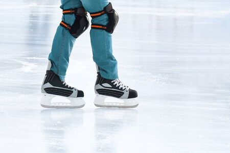 feet rolling on skates man on the ice rink. sports, Hobbies and recreation of active people