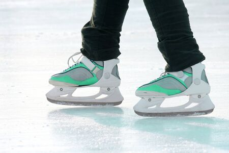 the legs of a man skating on the ice rink. sports, Hobbies and recreation of active people Imagens