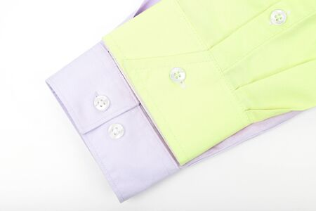 sleeves of yellow  and pink shirt on light background. fashion and beauty in clothes Imagens