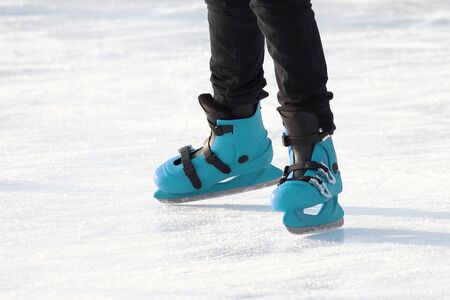 legs in blue skating on the ice rink. sports, Hobbies and recreation of active people