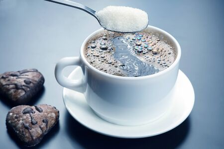 white cup with black coffee and spoon with sugar. hot drink Imagens