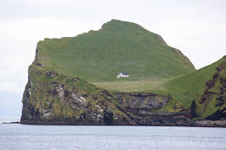 Lonely house on the Island of the Vestmannaeyjar archipelago. Iceland