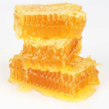 pyramid of honeycomb on white background. Healthy and vitamin food Imagens