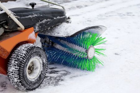 special machine for snow removal cleans the road. Cleaning and cleanliness of streets