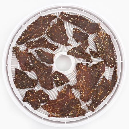 dried beef slices in spices with sesame seeds.  Healthy and vitamin food