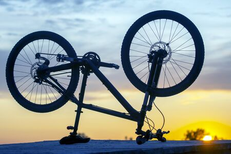 bicycle silhouette on sunset background
