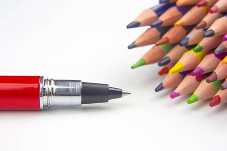 Colored pencils and pen for drawing on a white background. Education and creativity. Leisure and art Reklamní fotografie - 131987521