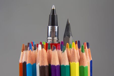 Colored pencils for drawing on a gray background. Education and creativity. Leisure and art Reklamní fotografie