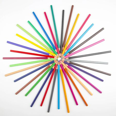 Colored pencils for drawing on a white background. Education and creativity. Leisure and art