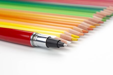 Colored pencils and pen for drawing on a white background. Education and creativity. Leisure and art