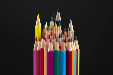 Colored pencils for drawing on a dark background. Education and creativity. Leisure and art Reklamní fotografie - 131987377