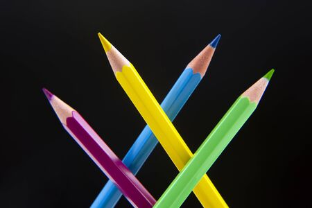 Colored pencils for drawing on a dark background. Education and creativity. Leisure and art