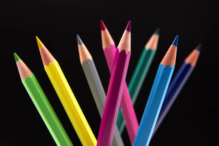 Colored pencils for drawing on a dark background. Education and creativity. Leisure and art Reklamní fotografie - 131987428