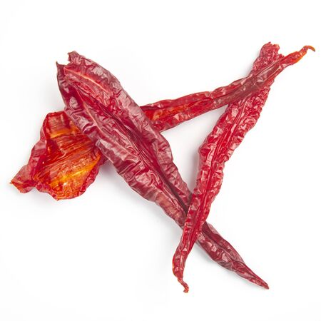 Dried hot red pepper on a white background. Food and spices.