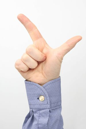 Male hand with two raised fingers on a white background  版權商用圖片