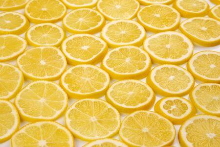sliced citrus lemons half on a light background