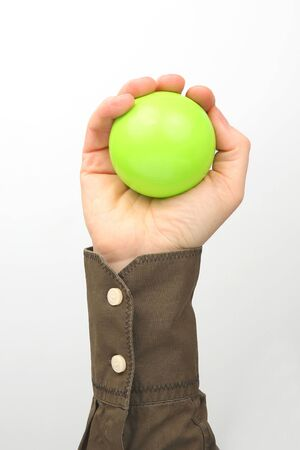 Male hand holds a ball on a white background