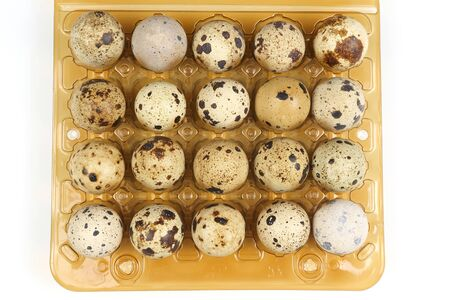 quail eggs in a box close-up on a white background Reklamní fotografie - 133689672