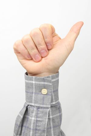 Male hand with thumb up on white background