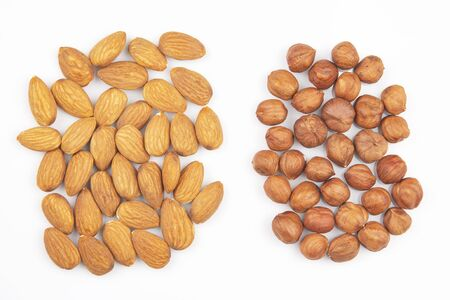 Different nuts on a white background. Vitamin wholesome food.