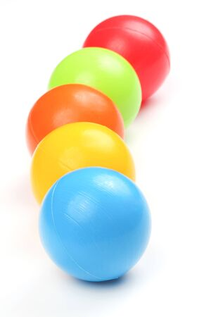 Colored plastic balls on white background