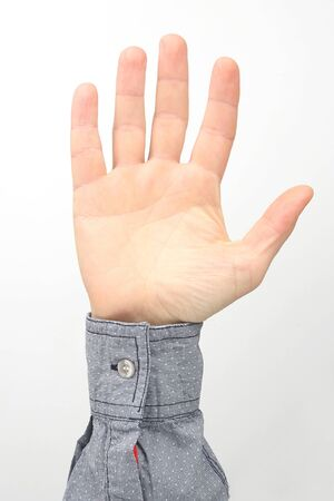 Male hands with raised fingers on a white background