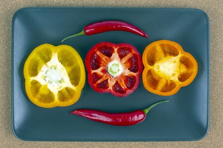 Fresh sweet and hot peppers on a plate. Vitamin wholesome food.