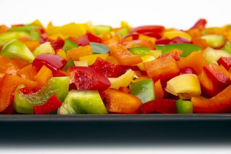 Sliced colored bell peppers on a plate. Vitamin healthy food.  版權商用圖片
