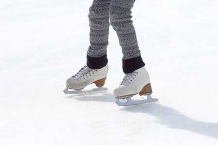 girl skates on ice rink. Sport and entertainment. Rest and winter holidays.