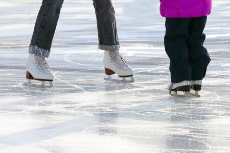 little girl with mother skate on the rink. Sport and entertainment. Rest and winter holidays.