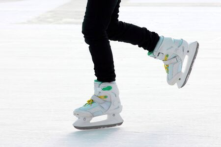 foot ice-skating person on the ice rink. Sport and entertainment. Rest and winter holidays.  版權商用圖片