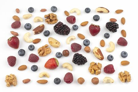 different berries and nuts on a white background. vitamin proteins and healthy foods