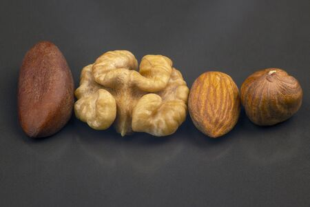 different nuts close-up on a gray background. Healthy food and vitamins