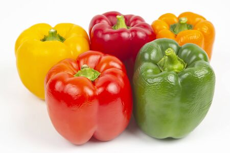 colored bell peppers on a white background. vitamin food Stock Photo