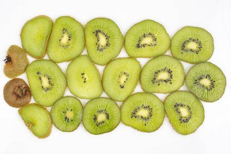 sliced kiwi fruit slices on a white background Reklamní fotografie
