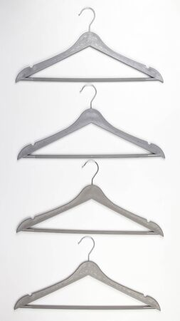 gray clothes hanger on a white background. The choice of style of fashionable clothes