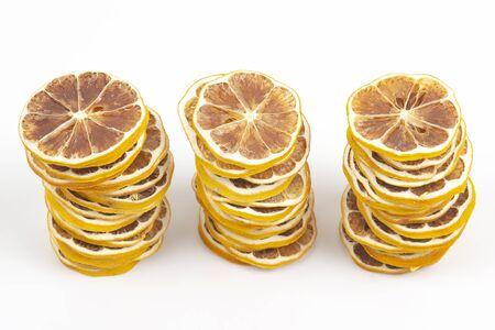 large number of dried lemon slices on a white background. vitamin fruit food Reklamní fotografie