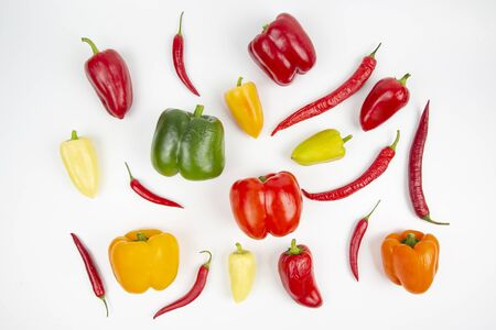 different colored sweet and bitter peppers on a white background. vitamin food Reklamní fotografie