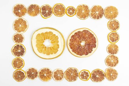 frame of dried lemon slices on a white background. vitamin fruit food