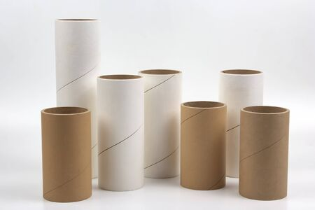 cardboard and paper tubes and pipes on a white background Stock Photo