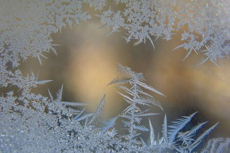 frosty patterns on the window glass closeup. natural textures and backgrounds. ice patterns on frozen