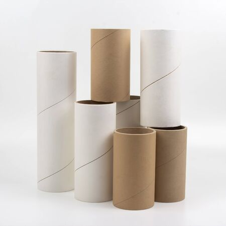 cardboard and paper tubes and pipes on a white background Imagens