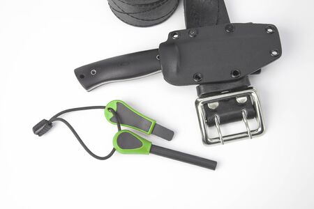 knife for tourism and hunting with a plastic case on a black leather belt on a white background. ignition steel for striking fire 스톡 콘텐츠